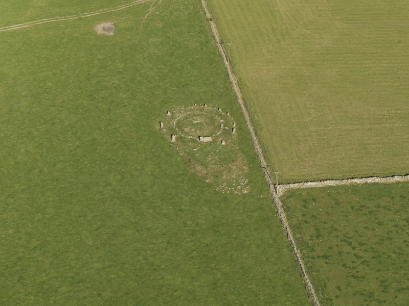 Oblique aerial view of the remains of the recumbent stone circle at Aquhorthies, taken from the SSW.