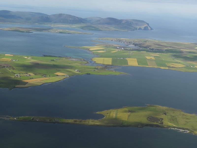 Oblique aerial view across the Loch of Harray with the Ring of Brodgar in the foreground and Hoy beyond, taken from the NE.