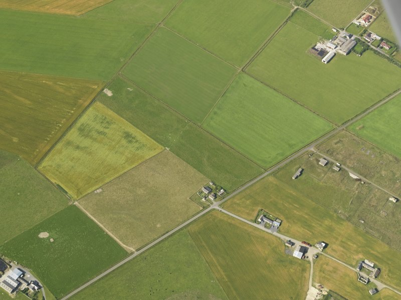 Oblique aerial view centred on the cropmarks of the possible enclosure, taken from the ENE.