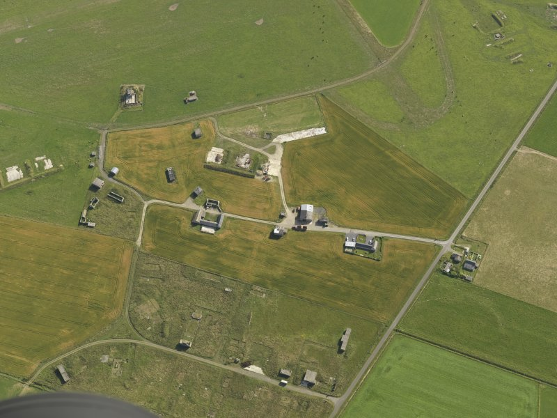 Oblique aerial view centred on the buildings of Twatt airfield, taken from the WSW.