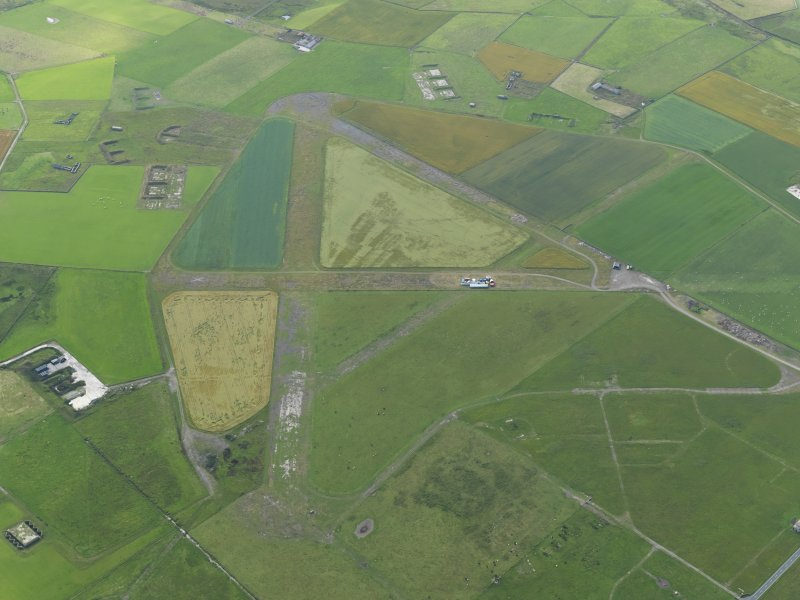 Oblique aerial view centred on Skeabrae airfield, taken from the NW.