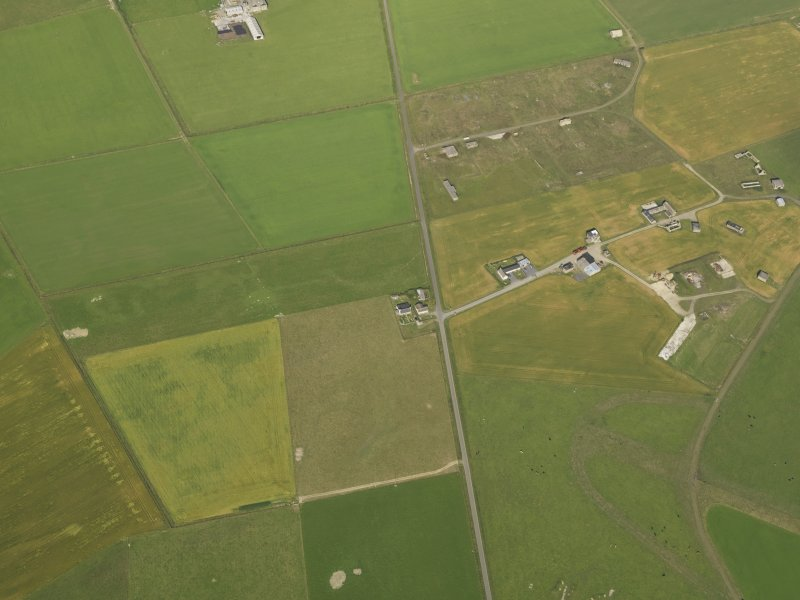 Oblique aerial view centred on the cropmarks of the possible enclosure, taken from the ESE.