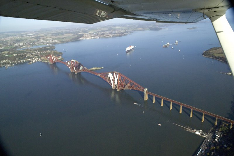 General oblique aerial view of the Forth Rail Bridge with the Queen Mary 2 in the back ground, taken from the SSW.