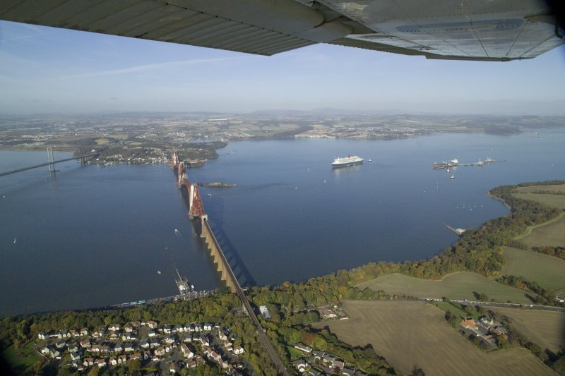 General oblique aerial view of the Forth Rail Bridge with the Queen Mary 2 in the back ground, taken from the S.