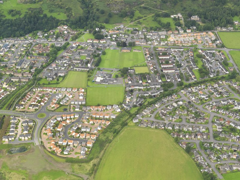 General oblique aerial view of Menstrie village, taken from the SSE.