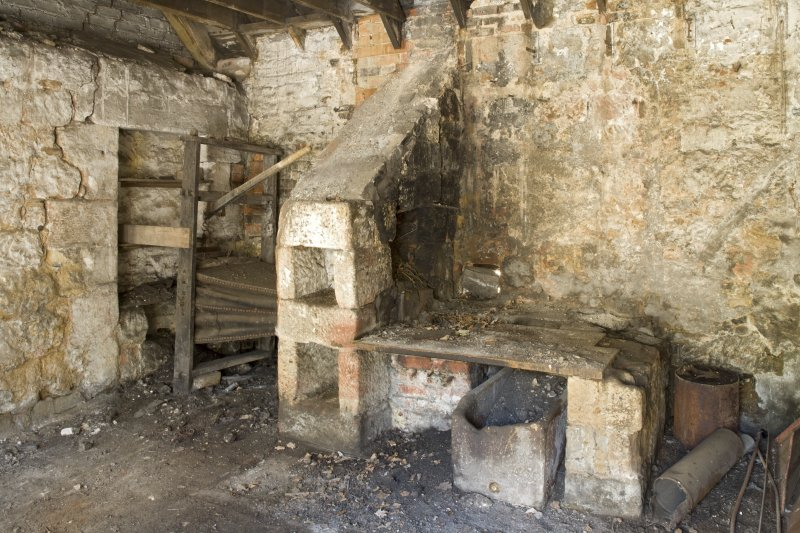 Interior. Smiddy, view of bellows and remains of forge