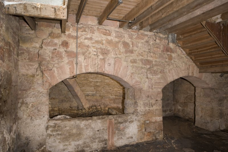 Interior. Kiln, view of arched openings at E end