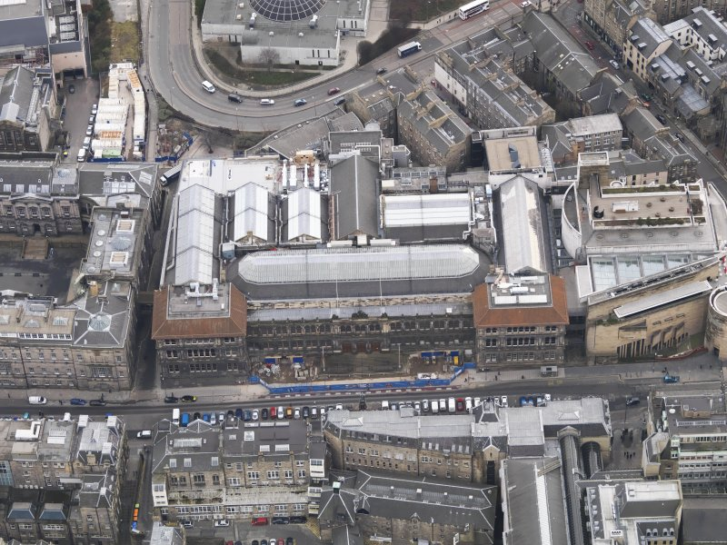 General oblique aerial view of Chambers Street centred on the Royal Museum of Scotland, taken from the N.