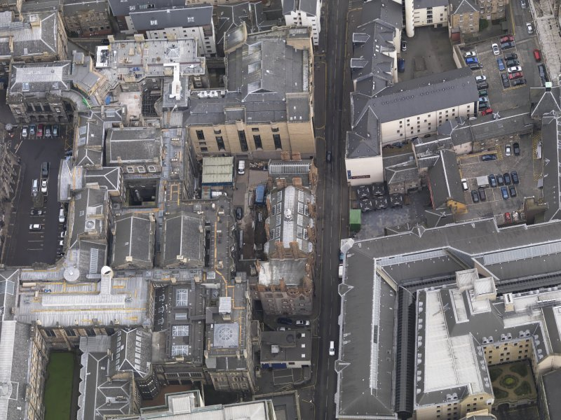 Oblique aerial view of the Cowgate, Edinburgh, centred on the Society of Solicitors' Library, taken from the W.