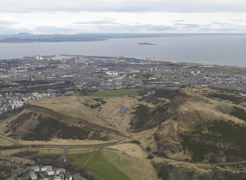 General oblique aerial view of the city (Leith) and the park centred on Salisbury Crags, taken from the SE.