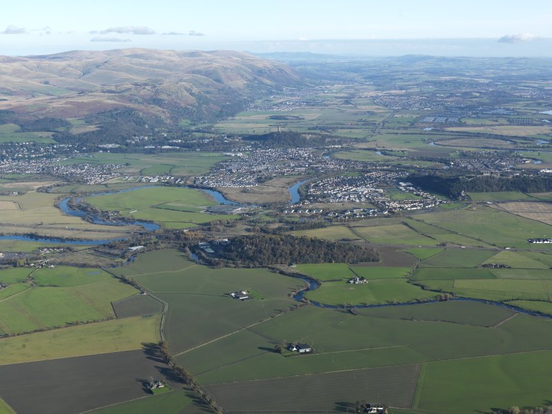 General oblique aerial looking towards The Ochils and The Wallace Monument, taken from the SW.