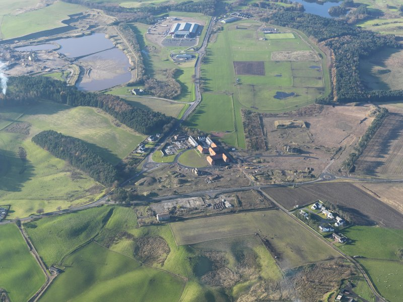 General oblique aerial view of Hyndford Quarry, Lanark racecourse and the redevelopment of Winston Barracks, taken from the ESE.