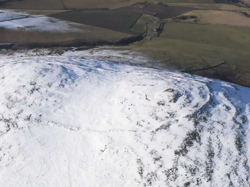 Oblique aerial view of Yeavering Bell fort, looking NNW.