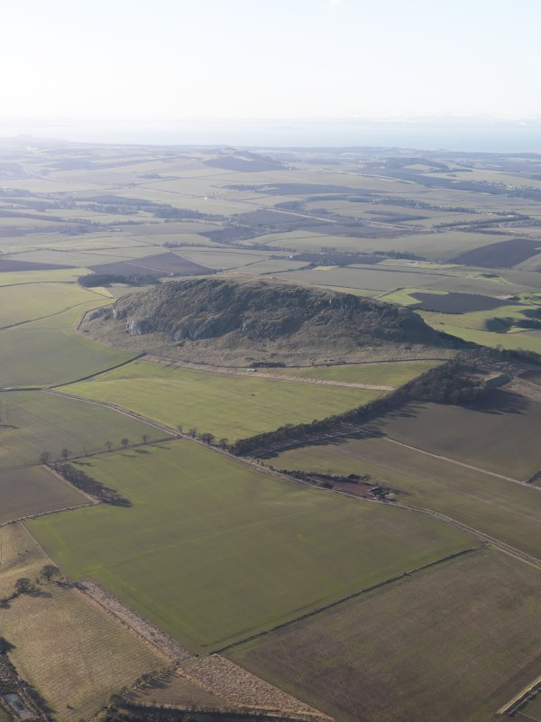 General oblique aerial view of Traprain Law fort, looking WNW.