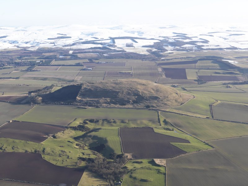 General oblique aerial view of Traprain Law fort, looking SSE.