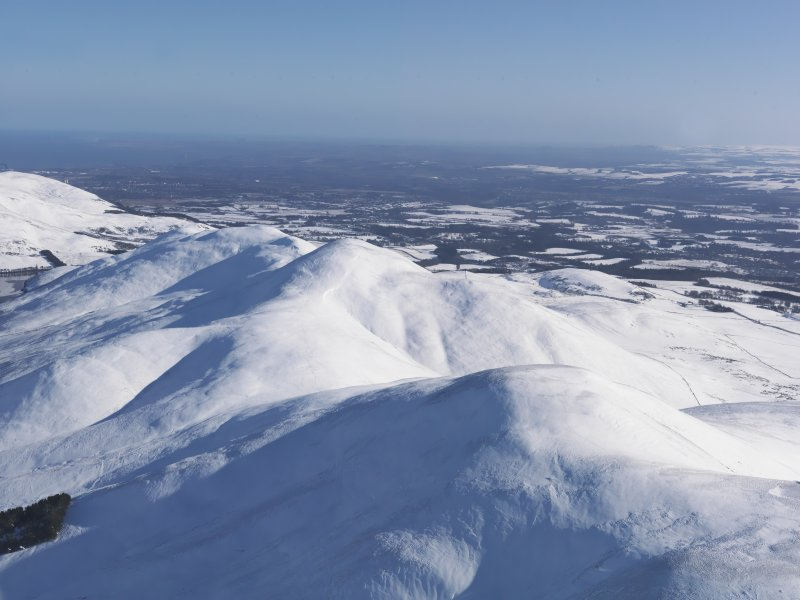 General oblique aerial view of Pentland Hills under snow with Carnethy Hill in the centre, looking ENE.