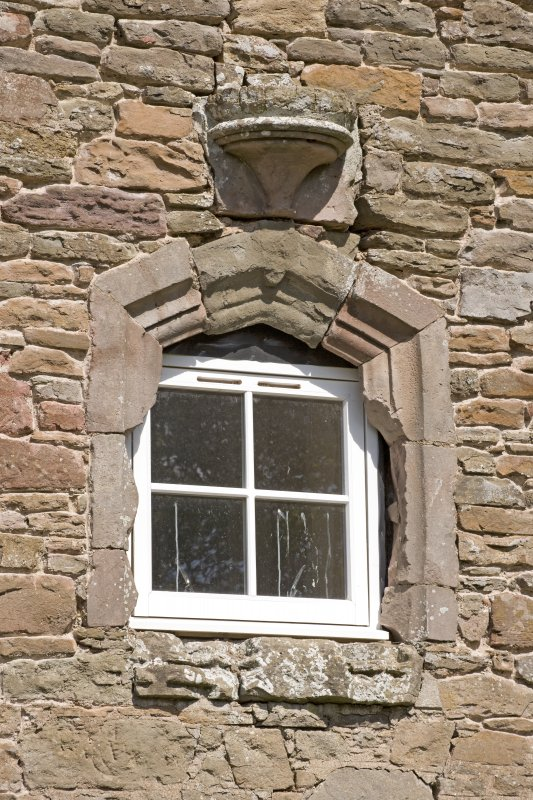 S range of steading, detail of window with re-used corbel above in S gable