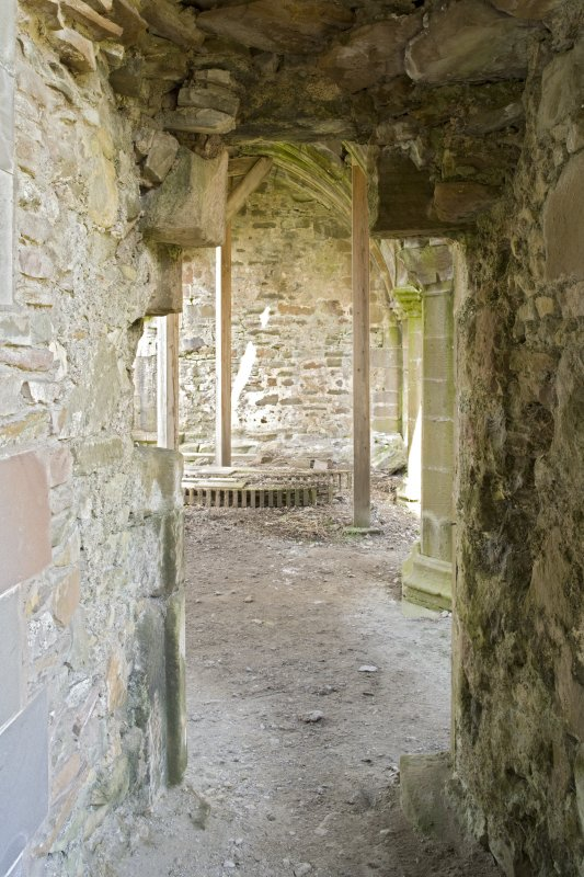 Doorway between chapter house and sacristy, view from S