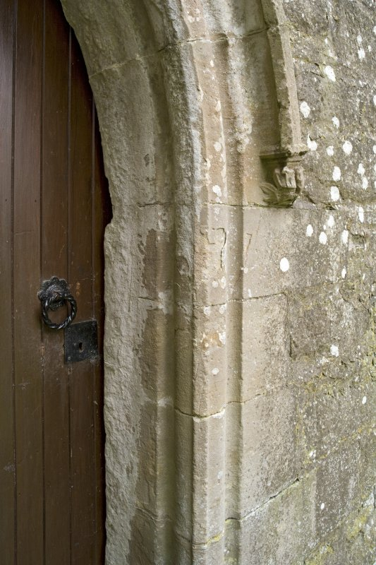 Slype, E doorway, detail of roll moulding and corbel