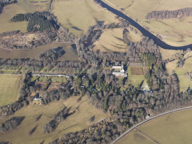 Oblique aerial view of Traquair House, looking NW.
