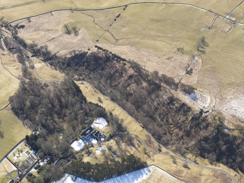 Oblique aerial view of the earthwork and Harden House, looking SW.