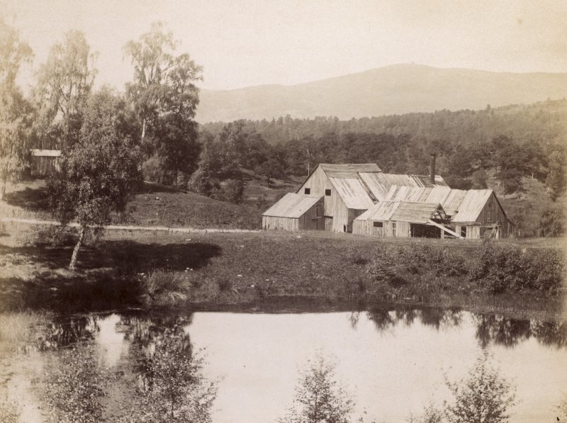 View of wooden buildings at Kinrara, near Aviemore.