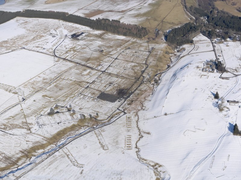 Oblique aerial view of Stobs Camp under snow, looking NNE.
