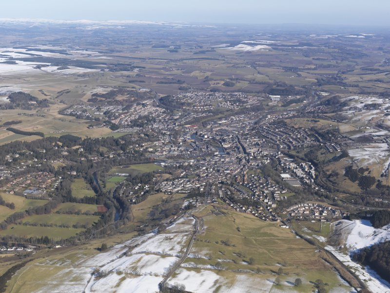 General oblique aerial view of Hawick with the Eildon Hills in the distance, looking NNE.