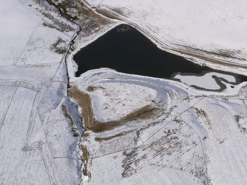 Oblique aerial view of the snow-covered remains of the fort at Green Castle, taken from the SE.