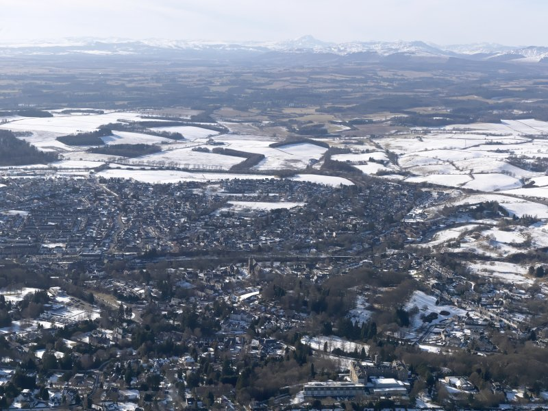 General oblique aerial view of Dunblane with the mountains beyond, looking W.
