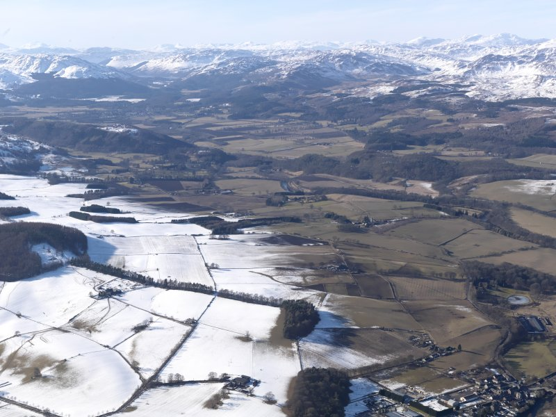 General oblique aerial view up the River Earn with the snow-covered mountains beyond, looking NW.