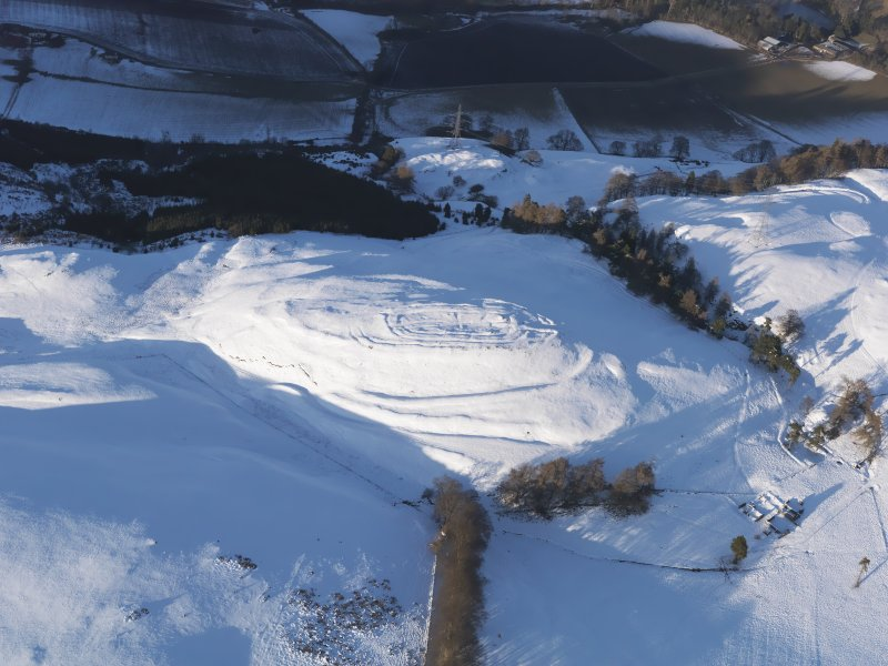 Oblique aerial view of Castle Law fort under snow, looking NNE.