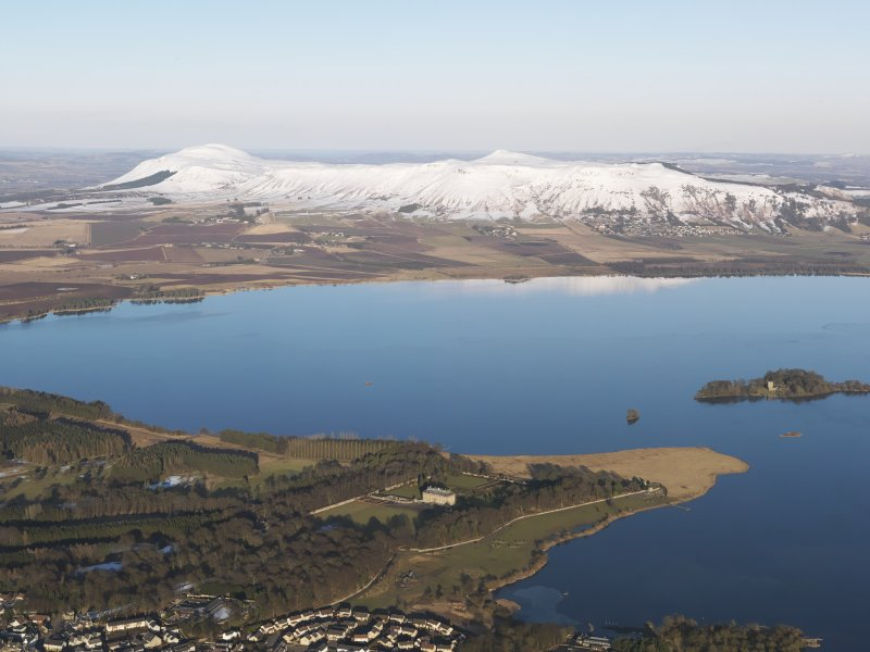 General oblique aerial view looking across Kinross House and Loch Leven towards the snow-covered Lomond Hills, looking ENE.