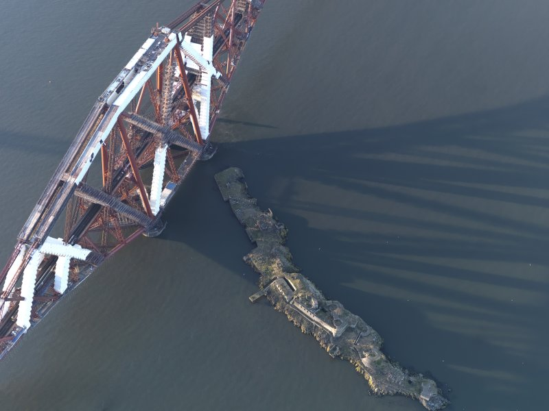 Oblique aerial view centred on the bridge pier, looking NW.