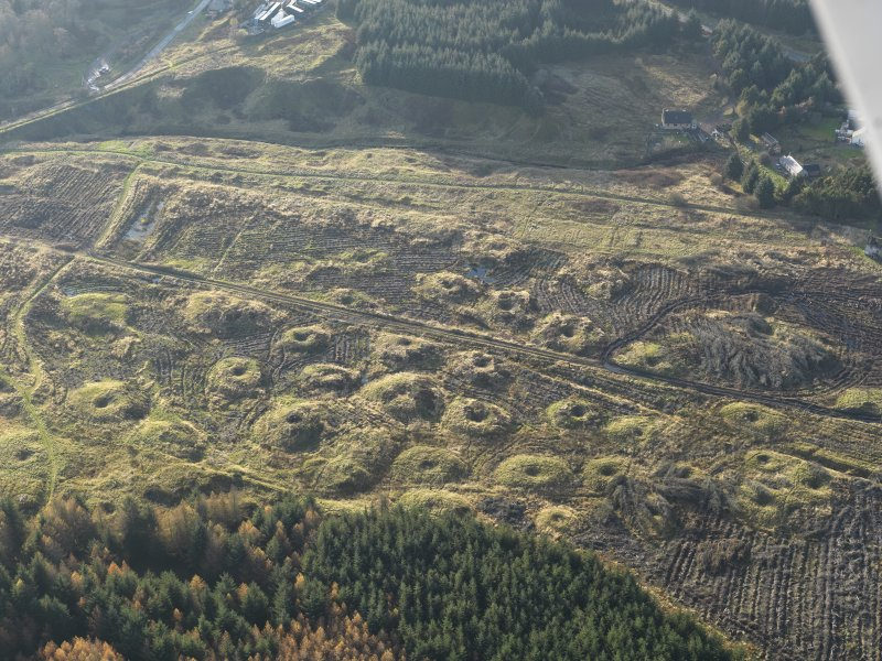 Oblique aerial view of the remains of the Wilsontown mine workings after clearance of trees, taken from the ENE.