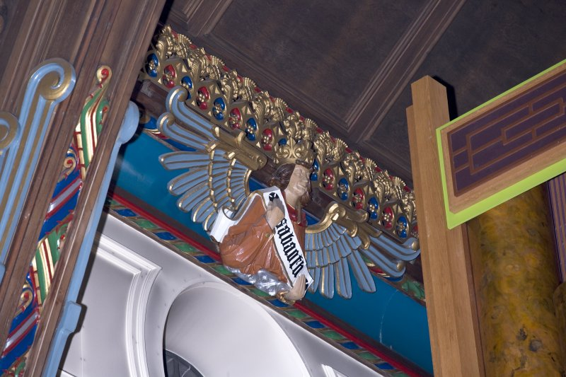 Interior. Nave, detail of angel at cornice level