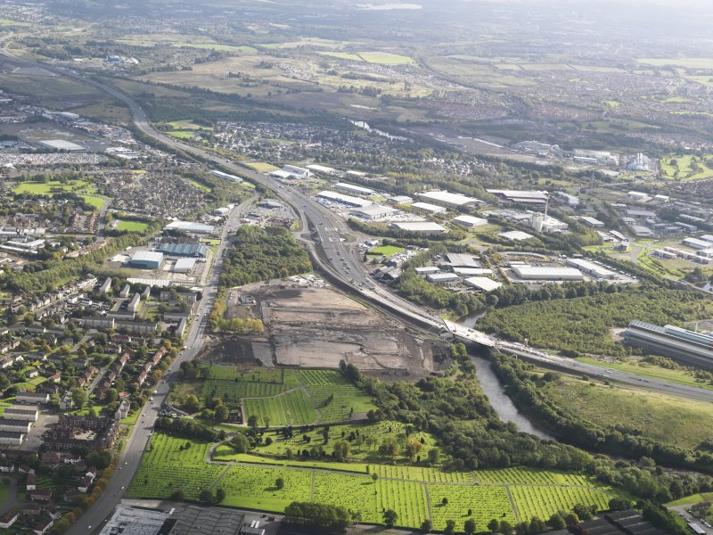 General oblique aerial view of the M74 extension looking E, centred on the Fullerton Road junction (NS 6408 6239 ) to Dalbeth Bridge area, taken from the W.