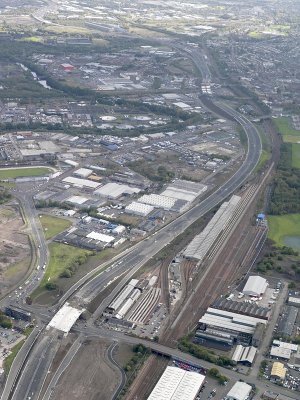 Oblique aerial view of the city showing the route of the M74 extension going from the Polmadie area to Dalbeth bridge centred on the Power Motive Works, taken from the W.