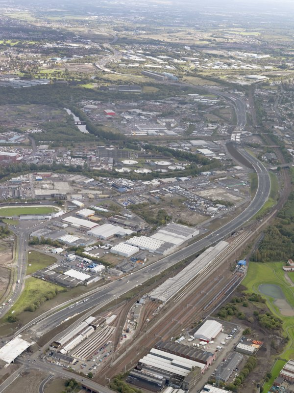 Oblique aerial view of the city showing the route of the M74 extension going from the Polmadie area to Dalbeth bridge centred on the Power Motive Works, taken from the W..