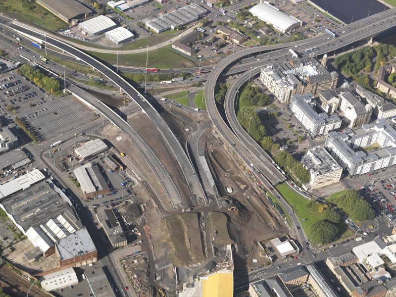 Oblique aerial view of the M74 extension meeting the M74 motorway at the Kingston bridge centred on the engine works, taken from the SE.