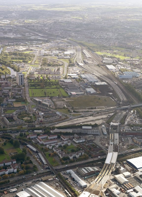 Oblique aerial view of the city showing the route of the M74 extension going from the Port Eglinton area to Polamdie area centred on the Power Motive Works looking E, taken from the W.