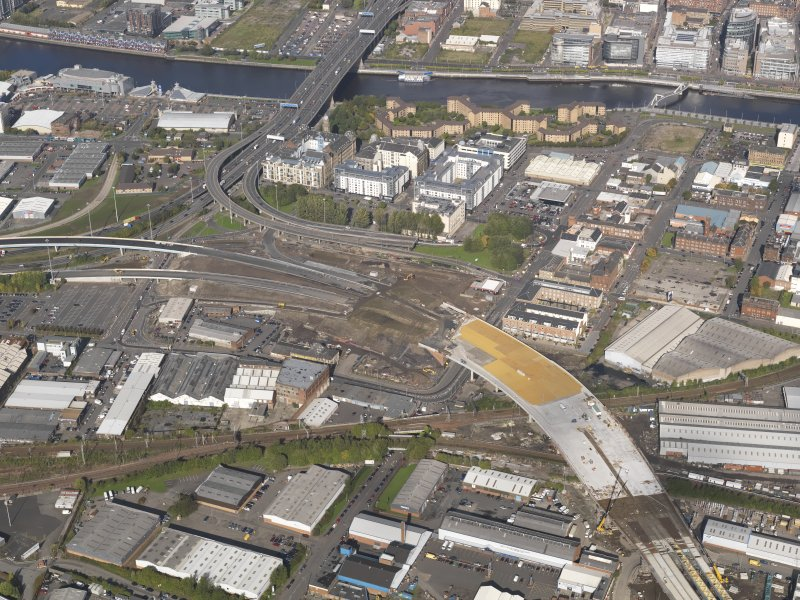Oblique aerial view of the M74 extension going through the Port Eglinton area centred on junction with the M74 at the Kingston Bridge, taken from the SE.