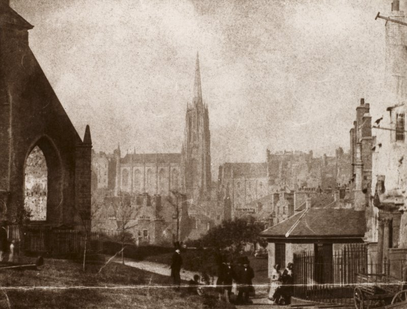 Photograph of Greyfriars Church, Churchyard and Lodge, looking over towards Victoria Hall/Tolbooth St John's Church, with visitors in the Greyfriars Churchyard Edinburgh Photographic Society Survey of Edinburgh and District, Ward XIV George Square