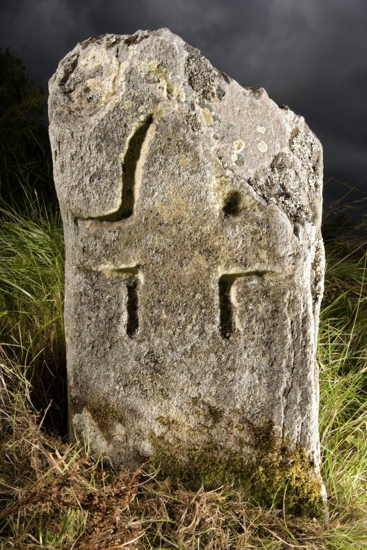 View of small cross incised stone