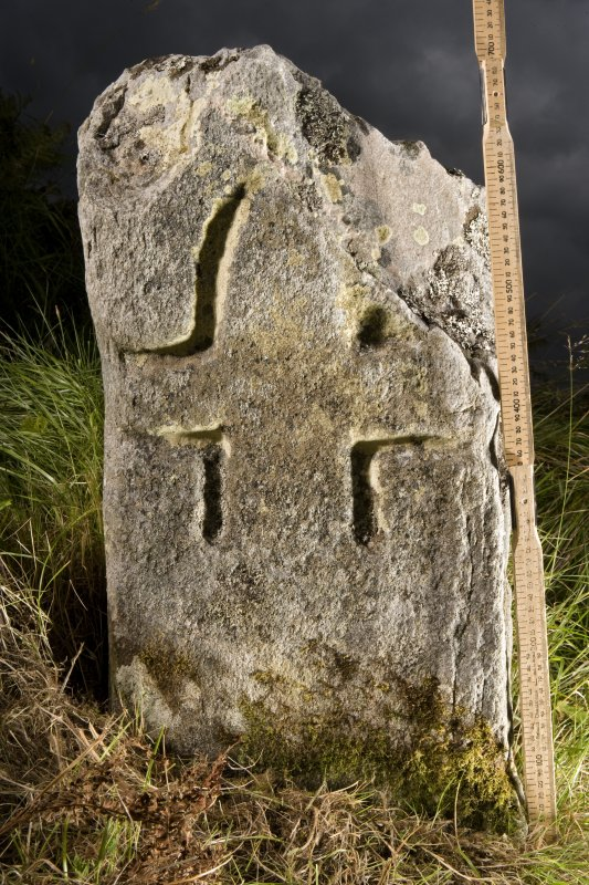 View of small cross incised stone (with scale)