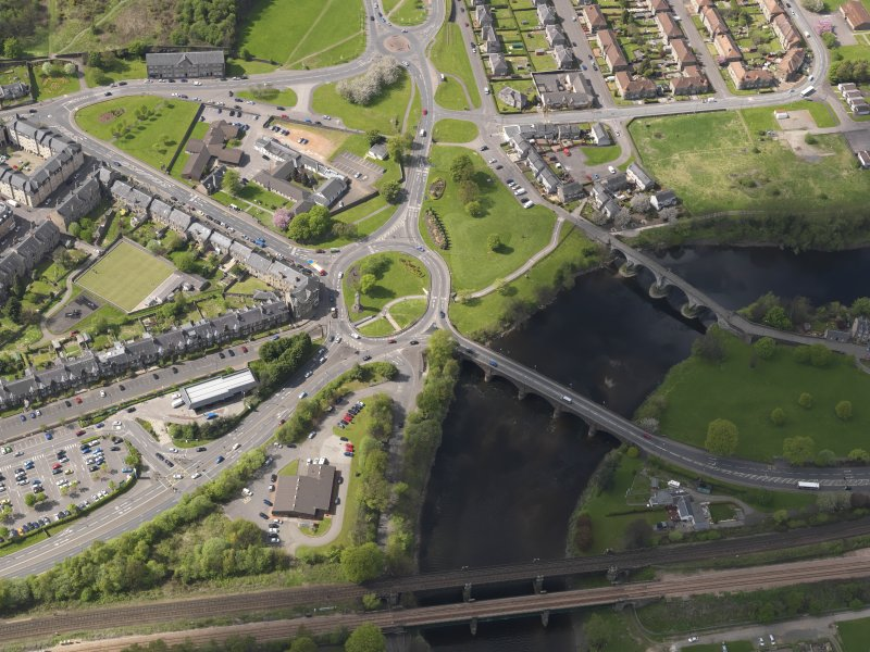 Oblique aerial view of the city centred on the Customs Roundabout, taken from the E.