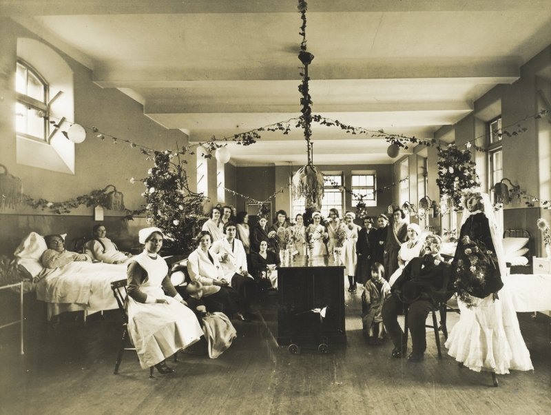 View of ward decorated for Christmas with patients and staff at Bruntsfield  Hospital. Bruntsfield 1933,  PHOTOGRAPH ALBUM No.174: Un-named album.