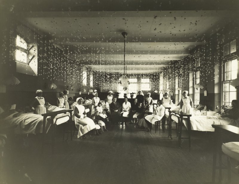 View of ward decorated for Christmas with patients and staff at Bruntsfield  Hospital. Bruntsfield 1932,  PHOTOGRAPH ALBUM No.174: Un-named album