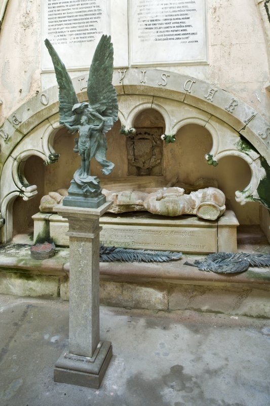 Detail. Interior. View of the South wall of the Argyll Mausoleum .The bronze sculpture on a pedestal in the foreground depicts Christ on the cross with an Angel.  Beneath the arch a niche contains the 15th century effigies of Sir Duncan Campbell and his wife, Marjory.