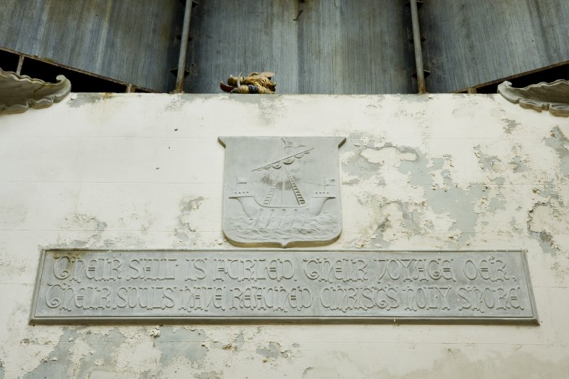 Interior. Detail. View of text panel and tablet with image of a sailing boat, situated at high level on the West wall of the Argyll Mausoleum. The text panel reads: 'Their sail is furled, their voyage oe'r, their souls have reached Christ's holy shore'.